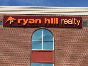 custom real estate storefront sign
